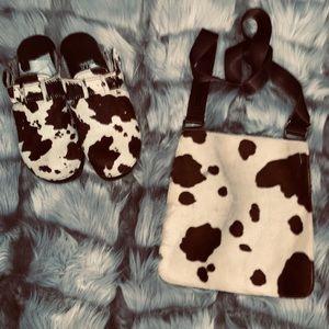 Brown cow print clogs